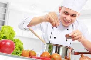 16800592-happy-smiling-male-chef-cooking-in-the-kitchen-Stock-Photo-food